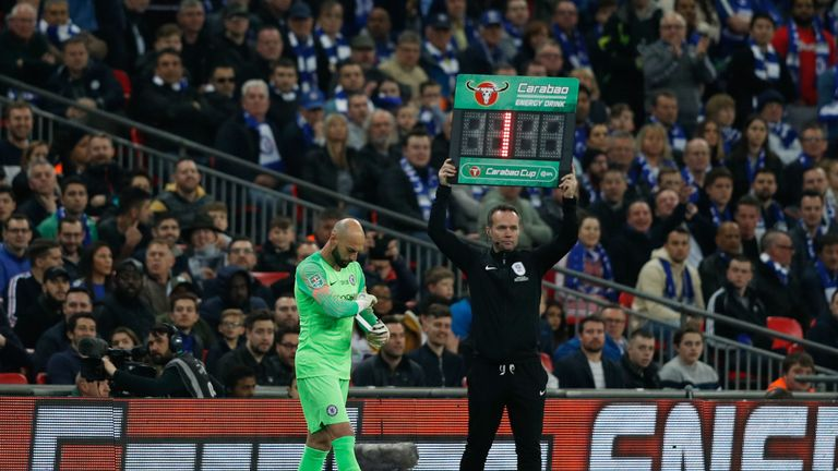 Willy Caballero waits for Kepa Arrizabalaga to leave the pitch after his number is raised by the fourth official