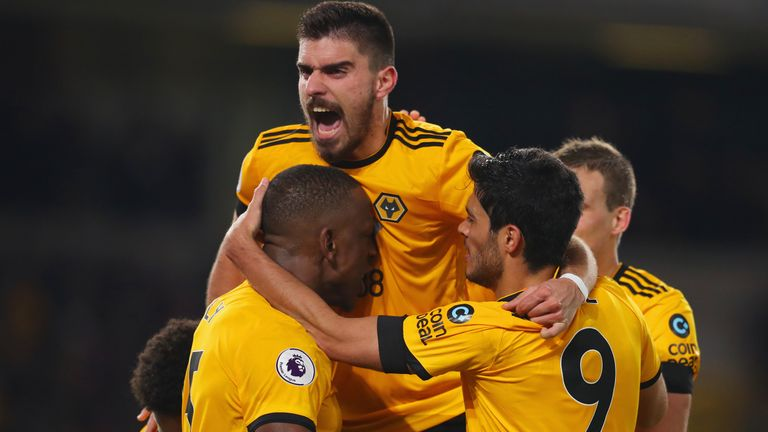 Wolves players celebrate Willy Boly's last-gasp equaliser against Newcastle