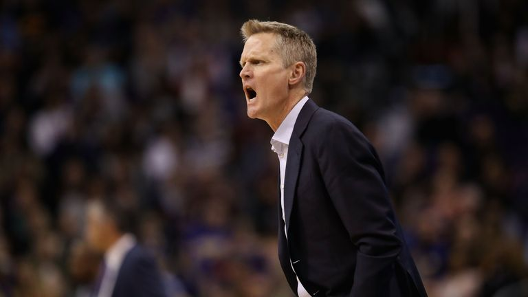 Steve Kerr bellows at officials from the Golden State bench