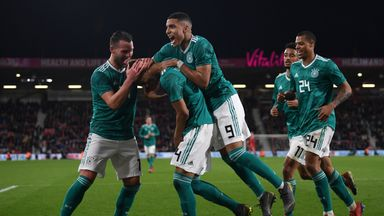 Felix Uduokhai is swamped by team-mates after scoring the winner for Germany U21