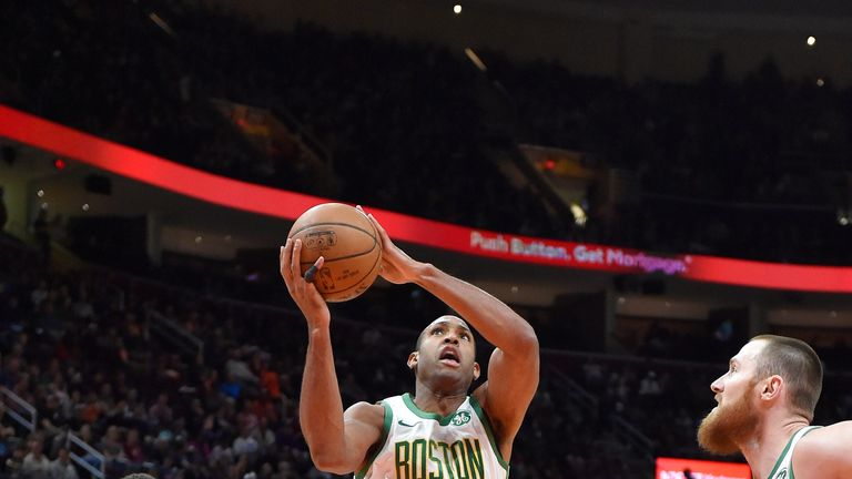 Al Horford gathers a rebound against Cleveland