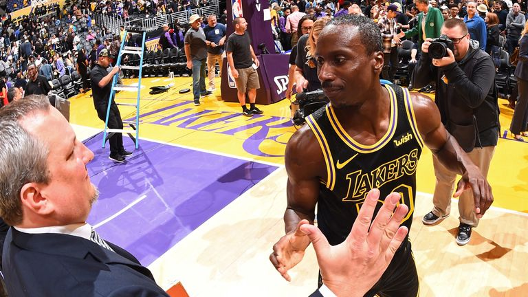 Andre Ingram receives congratulations after making his NBA debut as a 32-year-old