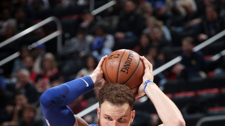 Blake Griffin faces up Jeremy Lin in Detroit's OT win over Toronto