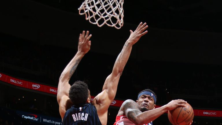 Bradley Beal absorbs contact from Khen Birch in Washington's win over Orlando