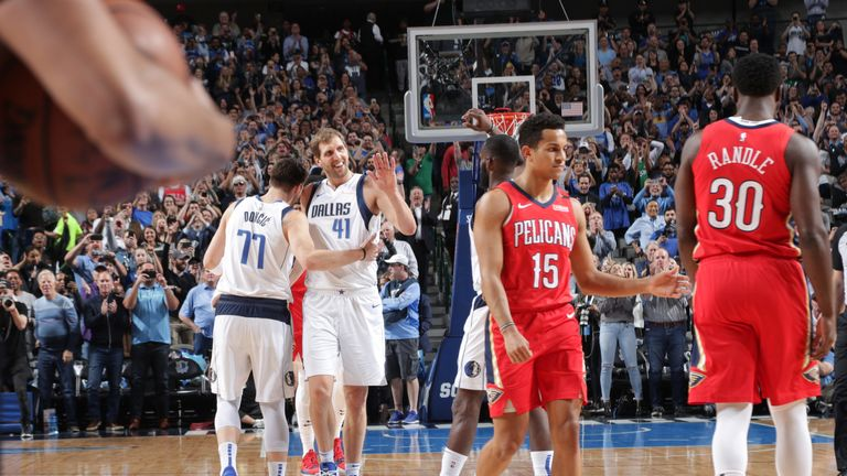 Dirk Nowitzki celebrates after passing Wil Chamberlain on the NBA all-time scoring list