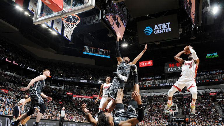 b940e0b36eab Dwyane Wade beats buzzer from inside his own half in Miami Heat win over San  Antonio Spurs