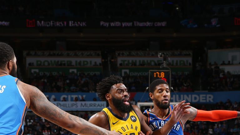 Tyreke Evans drives under pressure from Paul George