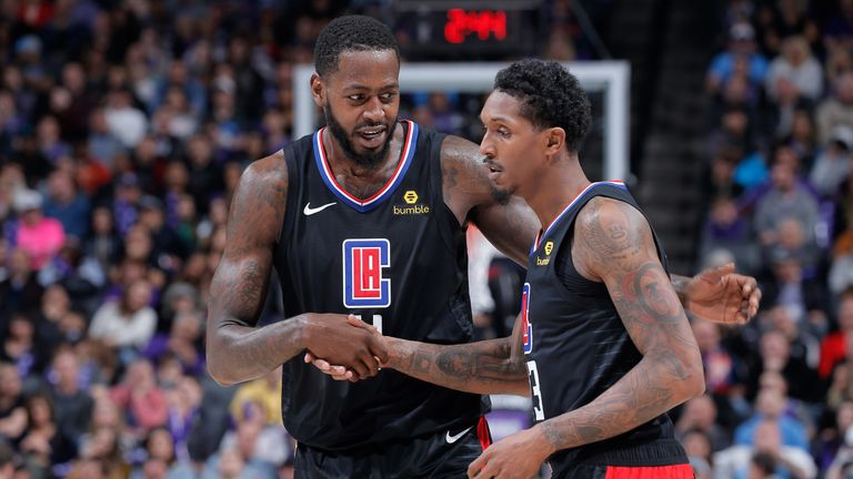 JaMychal Green congratulates Clippers team-mate Lou Williams