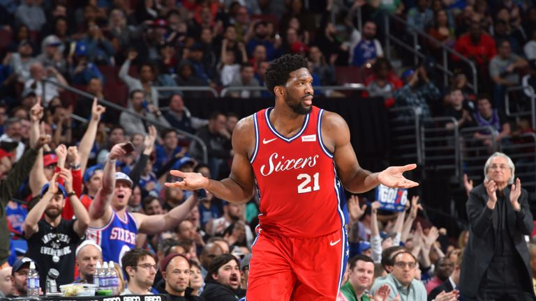 Joel Embiid gestures during the 76ers' win over Sacramento
