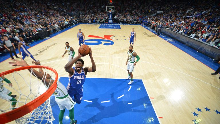 Joel Embiid absorbs contact to score against Boston