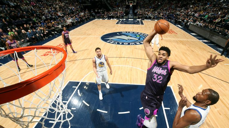 Karl-Anthony Towns dunks with authority against the Golden State Warriors