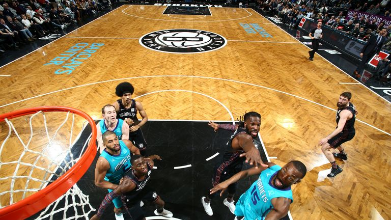 Kemba Walker attacks the basket against Brooklyn