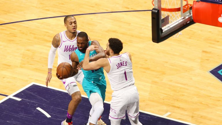 Kemba Walker absorbs contact while attacking the basket against Charlotte