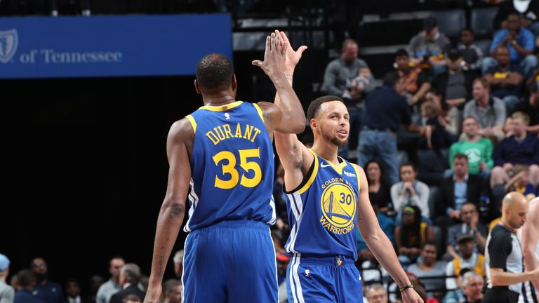 Kevin Durant and Stephen Curry share a high-five