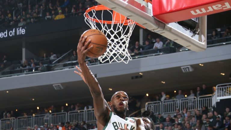 Khris Middleton finishes at the rim against the Los Angeles Lakers
