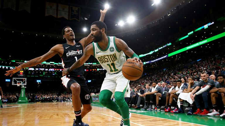 Kyrie Irving holds off Trevor Ariza