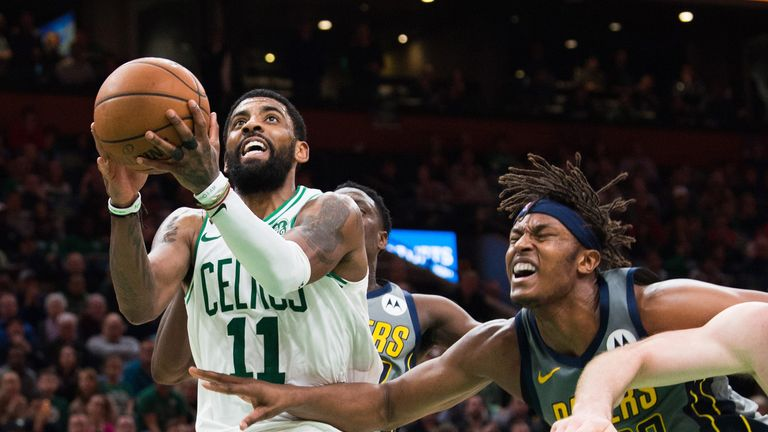 Kyrie Irving lofts a game-winning shot against Indiana