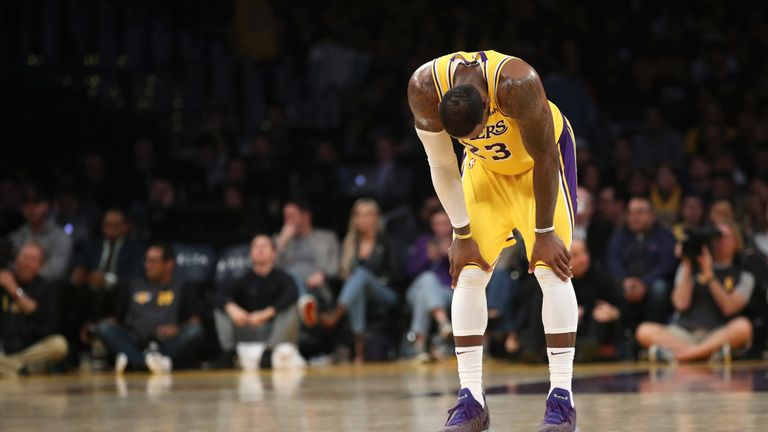 A dejected LeBron James reacts to another Lakers defeat