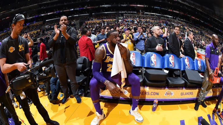 a05de2bdae1 LeBron James watches a video tribute on the Lakers jumbotron after passing  Michael Jordan on the