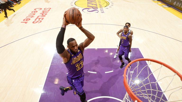 LeBron James hammers home a dunk in the Lakers' loss to the Brooklyn Nets