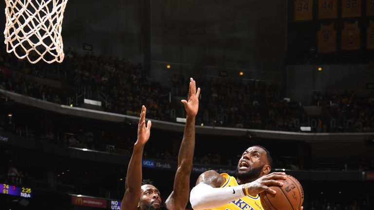 6ff70b79939 LeBron James absorbs contact in the paint against the Los Angeles Clippers