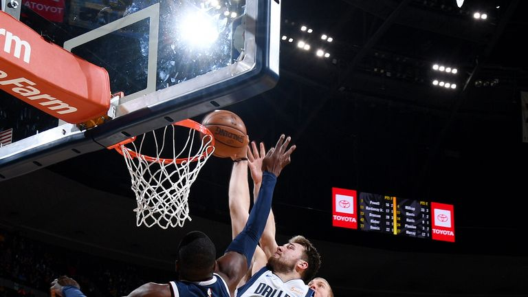 Luka Doncic throws down a huge dunk with five seconds remaining against the Denver Nuggets