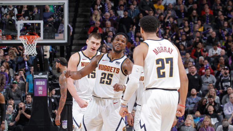 Malik Beasley celebrates with Nuggets starters Nikola Jokic and Jamal Murray