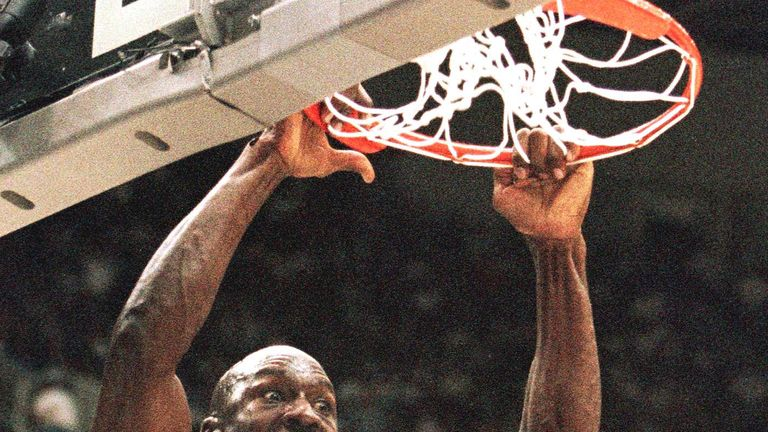 Michael Jordan throws down a two-handed dunk