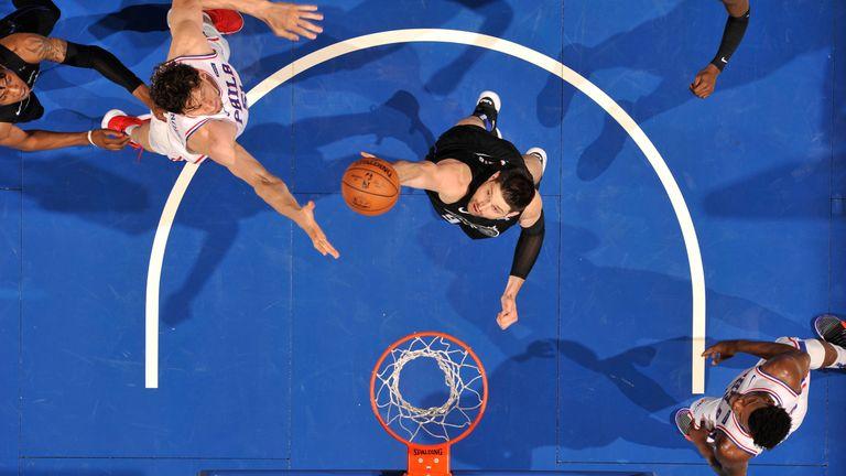 Nikola Vucevic pulls down a rebound against Philadelphia
