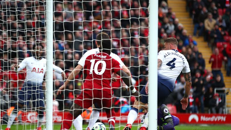 Toby Alderweireld scores a late own goal at Anfield to hand Liverpool a crucial win