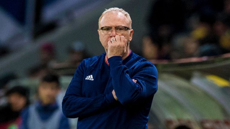 Scotland manager Alex McLeish watches on frustrated.