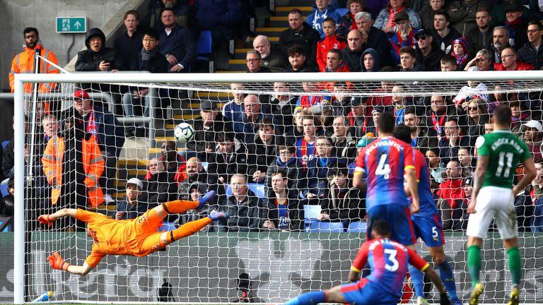 Anthony Knockaert curls his shot into the top left corner of Vicente Guaita's goal