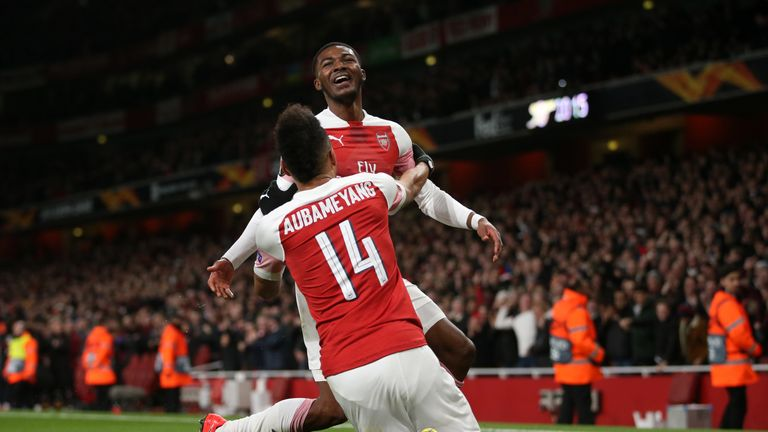 Ainsley Maitland-Niles celebrates scoring against Rennes with Aubameyang