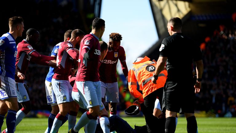Supporter is taken to the ground after attacking Jack Grealish