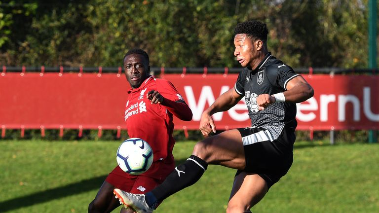 Liverpool 's Bobby Adekanye and Ali Koiki of Burnley in action during the Premier League Cup game at The Kirkby Academy on November 11, 2018