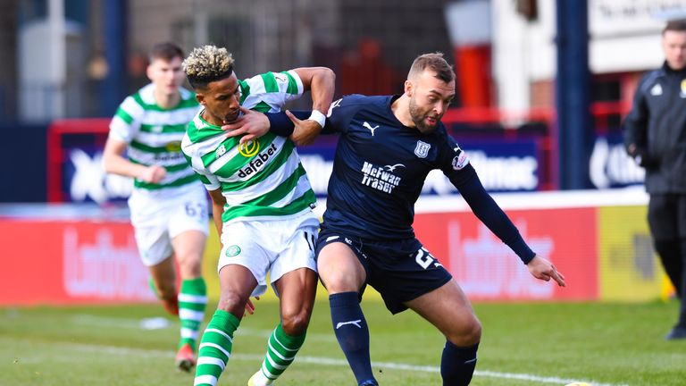 Scott Sinclair battles with Dundee's Jamie Horsfield in action at Dens Park
