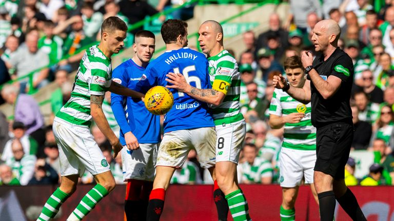 Scott Brown clashes with Andy Halliday during Celtic vs Rangers