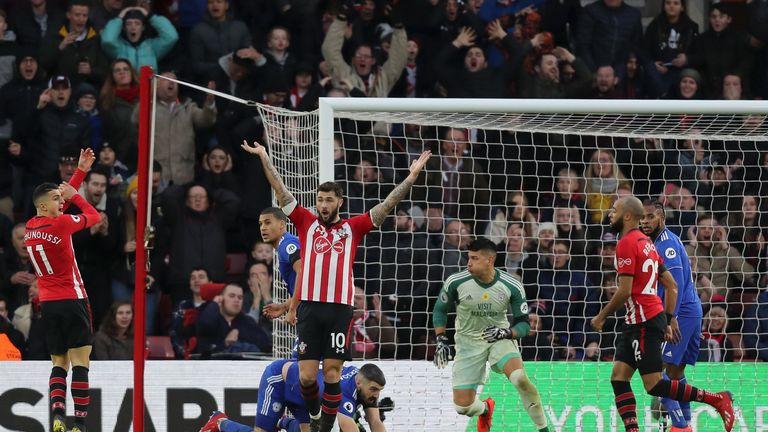 Southampton's Mohamed Elyounoussi and Charlie Austin appeal for handball