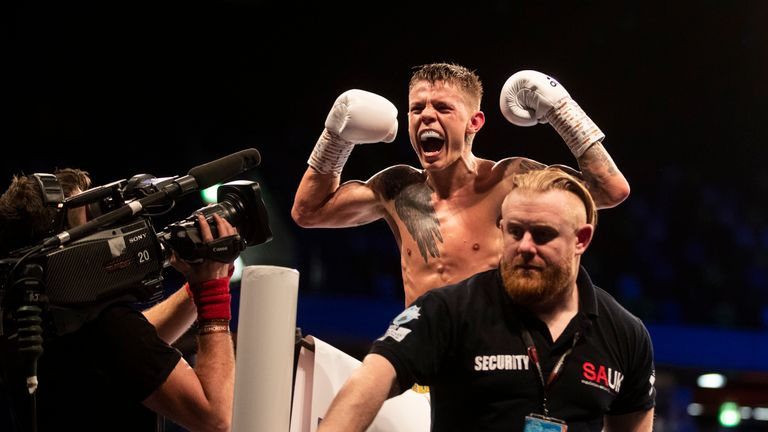 Charlie Edwards celebrates after successfully defending his WBC flyweight crown