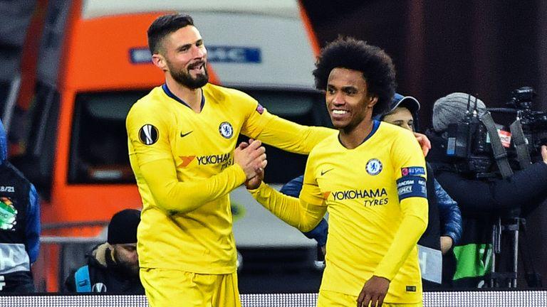 Hat-trick hero Olivier Giroud celebrates with Willian against Dynamo Kiev