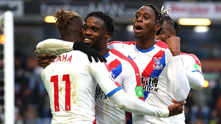 Wilfried Zaha of Crystal Palace celebrates after scoring his team's third goal with his team mates during the Premier League match between Burnley FC and Crystal Palace at Turf Moor on March 02, 2019 in Burnley, United Kingdom.