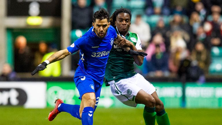 Rangers Daniel Candeias (left) and Hibernian's Stephane Omeonga in action