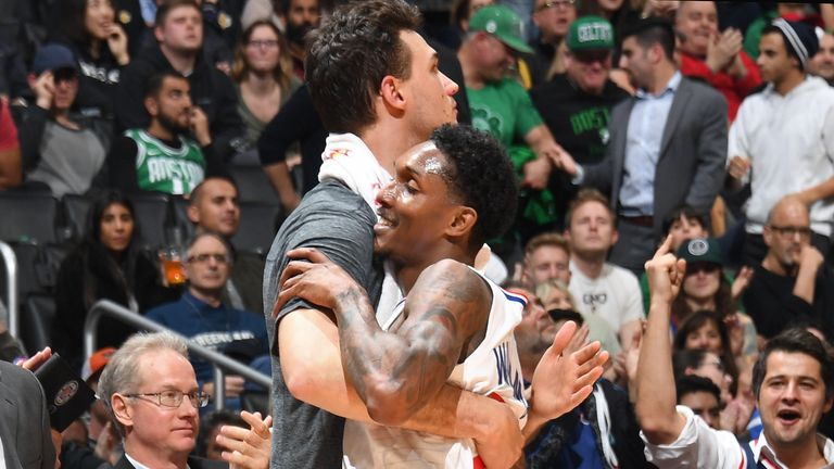 Danilo Gallinari #8, Lou Williams #23 of the LA Clippers hug each other during the game against the Boston Celtics on March 11, 2019 at STAPLES Center in Los Angeles, California.