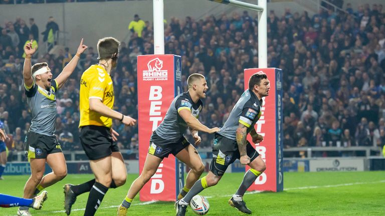 Danny Brough (right) celebrates scoring his side's sixth try - the 36-year-old also kicked five conversions and a drop goal