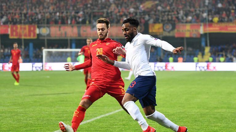 Danny Rose takes on Mirko Ivanic during England's European Qualifier against Montenegro