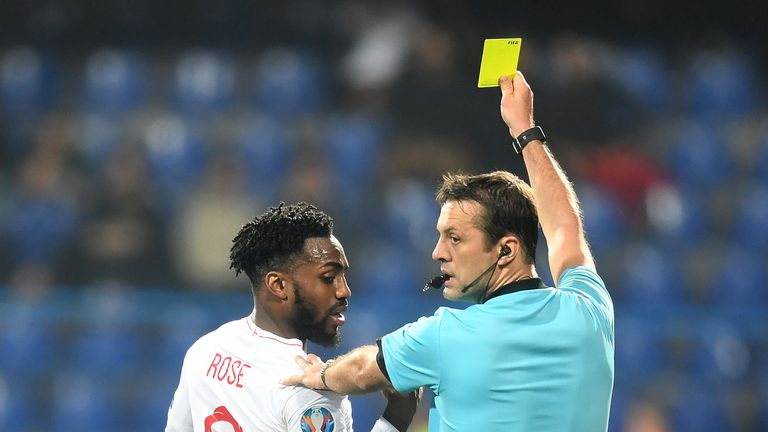 England's Danny Rose receives a yellow card against Montenegro in the European Qualifiers.