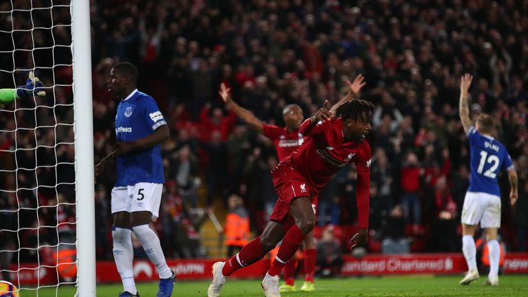 Divock Origi celebrates scoring his 96th-minute winner in December
