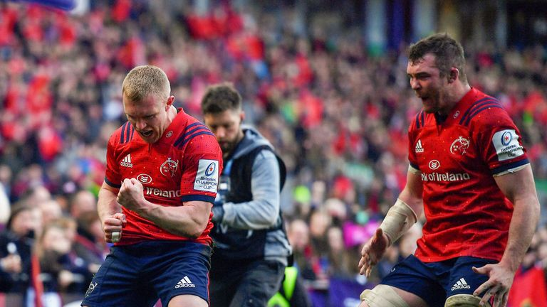 Keith Earls celebrates with team-mate Peter O'Mahony after scoring for Munster