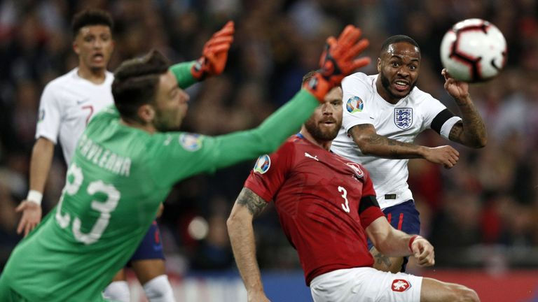 England's midfielder Raheem Sterling (R) watches as his shot beats Czech Republic's goalkeeper Jiri Pavlenka for England's third goal during the UEFA Euro 2020 Group A qualification football match between England and Czech Replublic at Wembley Stadium in London on March 22, 2019
