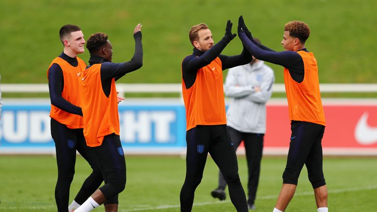 Tottenham stars Harry Kane and Deli Alli get stuck into training on Tuesday